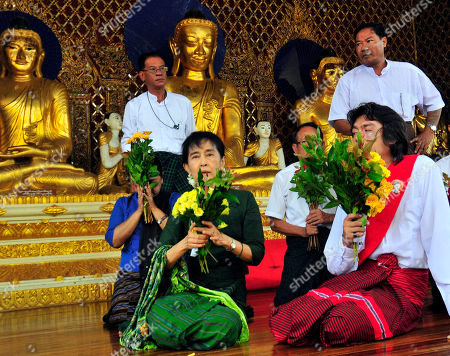 Aung San Suu Kyi, Kim Aris Myanmar democracy icon Aung San Suu Kyi, center, and her youngest son, Kim Aris, right, offer flowers at the Shwedagon pagoda in Yangon, Myanmar
