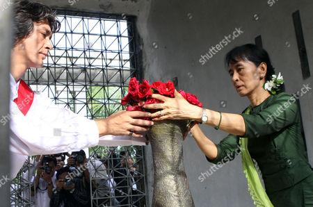 Aung San Suu Kyi, Kim Aris Myanmar democracy icon Aung San Suu Kyi and her youngest son Kim Aris, put flowers on tomb of her mother Daw Khin Kyi, in Yangon, Myanmar