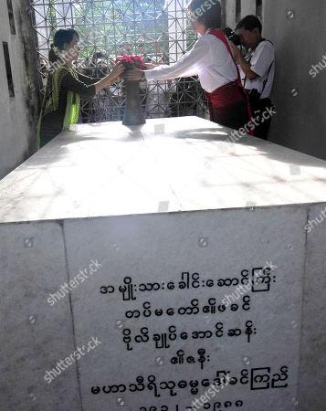 Aung San Suu Kyi, Kim Aris Myanmar democracy icon Aung San Suu Kyi and her youngest son, Kim Aris, put flowers on tomb of her mother Daw Khin Kyi, wife of General Aung San, in Yangon, Myanmar
