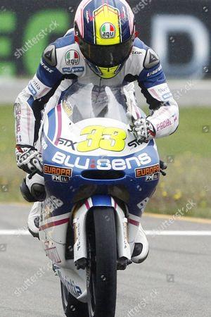 Sergio Gadea of Spain celebrates his third place as he rides his Aprilia during the 125cc race of the Dutch Grand Prix in Assen, northern Netherlands