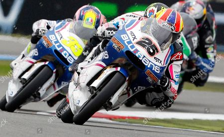 Maverick Vinales of Spain rides his Aprilia, center with number 25, to win the 125cc race of the Dutch Grand Prix ahead third place Sergio Gadea of Spain on Aprilia, left, in Assen, northern Netherlands