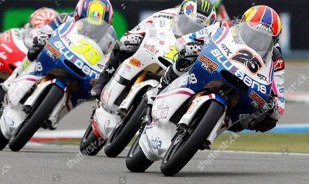 Maverick Vinales of Spain rides his Aprilia, right with number 25, to win the 125cc race of the Dutch Grand Prix ahead third place Sergio Gadea of Spain on Aprilia, left with number 33, in Assen, northern Netherlands, . In second place is Sandro Cortese of Germany on his Aprilia