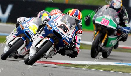 Stock Picture of Maverick Vinales of Spain rides his Aprilia, center with number 25, to win the 125cc race of the Dutch Grand Prix ahead of second place Louis Salom of Spain on Aprilia, right, and third place Sergio Gadea of Spain on Aprilia, left, in Assen, northern Netherlands