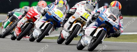 Stock Photo of Maverick Vinales of Spain rides his Aprilia, right with number 25, to win the 125cc race of the Dutch Grand Prix ahead third place Sergio Gadea of Spain on Aprilia, center with number 33, in Assen, northern Netherlands, . In second position is Sandro Cortese of Germany on his Aprilia