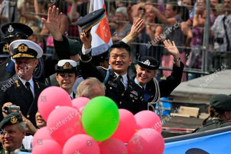"""Lt. Dan Choi, a discharged openly gay US Army veteran who has been an outspoken critic of the military's """"don't ask, don't tell"""" policy, second right, takes part in the Gay Pride canal parade in Amsterdam, . The Dutch Defense Ministry is sponsoring a boat in the annual festival for the first time this year, underscoring the long-standing policy of accepting of homosexuals in the military, starkly contrasting with the """"Don't Ask, Don't Tell"""" (DADT) policy of the US military"""