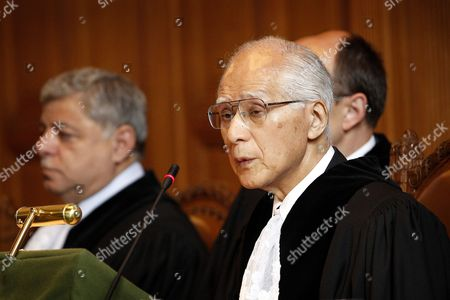 Judge Owada, Judge Awn Shawkat Al-Khasawneh Judge Awn Shawkat Al-Khasawneh, left, and President of the court Japan's Judge Owada, right, are seen at the International Court of Justice in The Hague, Netherlands, . Thailand and Cambodia will face off at the United Nations' highest court Monday, in the latest move to settle a decades-old battle for control of a disputed border region that has erupted into deadly military clashes. Cambodia is asking the court to order Thailand to withdraw troops and halt military activity around a temple at the center of the dispute between the Southeast Asian neighbors