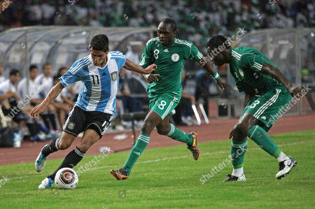 Nigeria's Taye Taiwo, right, and Peter Utaka, centre, challenge Argentina's Franco Jara, during an international friendly match between the two nations at the National stadium in Abuja, Nigeria