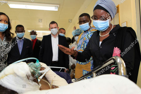 Asha-Rose Migiro United Nations Deputy Secretary-General Asha-Rose Migiro, right, gestures to a man injured in Friday's suicide attack on U.N. headquarters, as she visits victims of the blast in the intensive care unit of the national hospital, in Abuja, Nigeria . The death toll from the car bombing at the U.N.'s Nigeria headquarters has risen to 23, a U.N. spokesman said Sunday, making Friday's attack one of the deadliest attacks on the U.N. in a decade