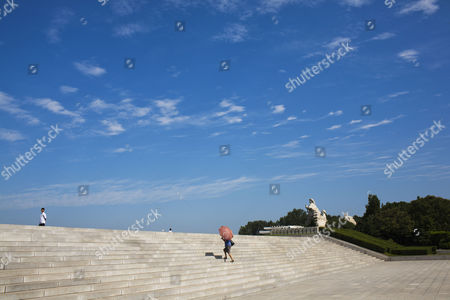 A North Korean woman uses a parasol to protect herself from the sun as she climbs a flight of stairs in Pyongyang. It's hard to imagine a North Korea without Kim Jong Il, who led the nation for 17 years until his death on Dec. 17. His death marks the end of an era for North Korea, which has known only two leaders: Kim and his father, Kim Il Sung. Already, a new era has begun under the leadership of his young son, Kim Jong Un. Still, Kim Jong Il's presence is felt in every frame of a series of images made by Associated Press photographer David Guttenfelder. During the last months of Kim's life, Guttenfelder, along with AP Korea Bureau Chief Jean H. Lee, made several trips to North Korea