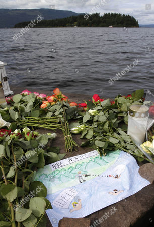 A child's drawing is placed among flowers in Utvika near Utoya island Norway, where a gunman Anders Behring Breivik killed at least 76 people. Title reads 'Not good', swimmers call 'help' and 'don't shoot'. The defense lawyer for Anders Behring Breivik Geir Lippestad told reporters Tuesday that the suspect in the bombing on the capital and the brutal attack on a youth camp that killed at least 76 people is not aware of the death toll or of the public's response to the massacre that has rocked the country