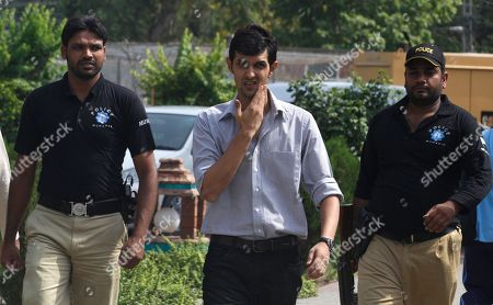 Pakistani controversial cricketer Zulqarnain Haider, center, arrives at the Pakistan Cricket Board to appear before a disciplinary committee in Lahore, Pakistan on . Haider was fined US$5,800 for violating code of conduct when he flee to London during the one-day series against South Africa in United Arab Emirates last year