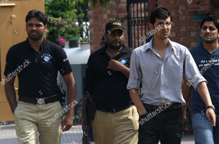 Pakistani controversial cricketer Zulqarnain Haider, second from right, arrives at the Pakistan Cricket Board to appear before a disciplinary committee in Lahore, Pakistan on . Haider was fined US$5,800 for violating code of conduct when he flee to London during the one-day series against South Africa in United Arab Emirates last year
