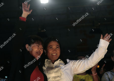 Keiko Fujimori, Susana Higuichi Peru's presidential candidate Keiko Fujimori of the political party Fuerza 2011, right, and her mother Susana Higuchi, left, wave to supporters during a closing campaign rally in Lima, Peru, . Keiko, daughter of former Peru's President Alberto Fujimori, will face Ollanta Humala of the Gana Peru party, in a presidential runoff June 5
