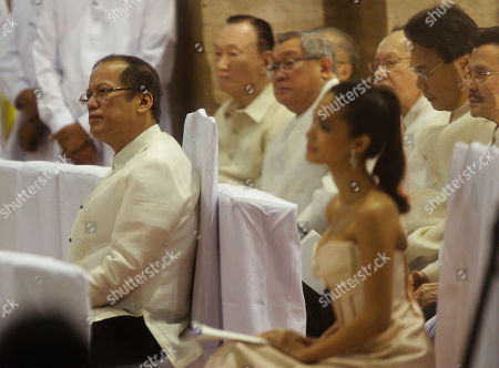 Benigno Aquino III, Heart Evangelista Philippine President Benigno Aquino III, left, listens to a mass during the 40th wedding anniversary of Philippine Senator Miriam Santiago and Narciso at Manila's Cathedral, Philippines on . At right is Filipino actress Heart Evangelista