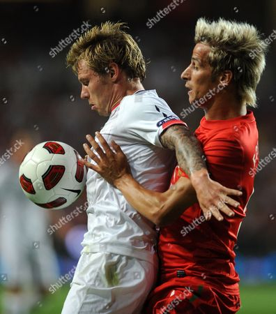 Portugal's Fabio Coentrao, right, is challenged by Norway's Bjorn Helge Riise during their Euro 2012 Group H qualifying soccer match at Luz stadium in Lisbon