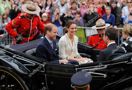 Stock Photo of Prince William, Kate Middleton, Prince William and Kate, Duke and Duchess of Cambridge, Robert Ghiz, Dr. Kate Ellis Ghiz Prince William and his wife Kate, the Duke and Duchess of Cambridge, seated aboard the state landau with Prince Edward Island Premier Robert Ghiz and his wife, Dr. Kate Ellis Ghiz, outside the Province House in Charlottetown, Prince Edward Island, as part of their Royal Tour of Canada
