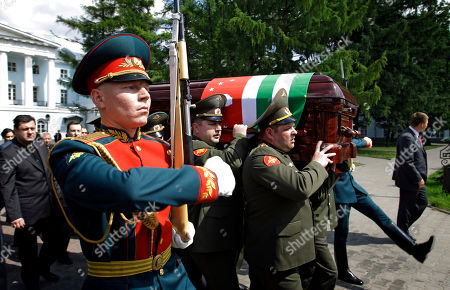 Honor guards march as the coffin of Abkhazia's separatist President Sergei Bagapsh is carried during a ceremony in Moscow, Russia, . Bagapsh died in a hospital on Sunday, May 29, aged 62