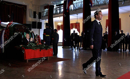Dmitry Medvedev Russian President Dmitry Medvedev walks, right, during a farewell ceremony for Abkhazia's separatist President Sergei Bagapsh in Moscow, Russia, . Bagapsh died in a hospital on Sunday, May 29, aged 62