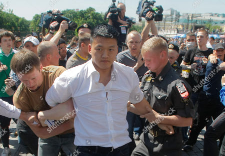 Stock Picture of Daniel Choi Russian police officers, including a plain clothed officer at left, detain a gay rights activist Daniel Choi during an attempt to hold a gay pride parade in Moscow, Russia