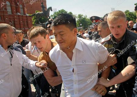 Daniel Choi Russian police officers, including a plain clothed officer at left, detain a gay rights activist Daniel Choi during an attempt to hold a gay pride parade in Moscow, Russia, . Opponents of gay rights scuffled with the demonstrators and with police in the Saturday actions. A police spokesman, Maxim Kolosvetov, told Russian news agencies that 18 gay activists and 14 opponents were arrested. Moscow authorities routinely ban gay rights demonstrations. Although homosexuality was decriminalized in post-Soviet Russia, anti-gay sentiment is high and authorities justify the bans on the grounds of trying to prevent fights