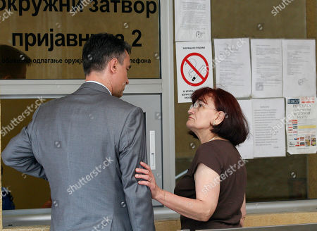Bosiljka Mladic, the wife of genocide suspect Ratko Mladic, right, speaks with their son Darko in front of the Special Court building in Belgrade, Serbia, . Ratko Mladic is eating strawberries and receiving family visits in a Serbian jail, but as early as Monday the ex-general could be on his way to face a war-crimes tribunal in The Hague, possibly joining his former ally Radovan Karadzic on trial for some of the worst horrors of the Balkan wars