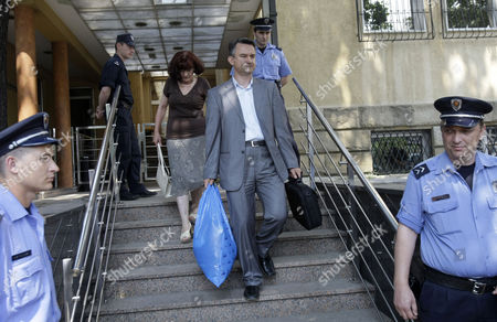 Bosiljka Mladic, Darko Mladic Darko Mladic, the son of genocide suspect Ratko Mladic, center, and Ratko's wife Bosiljka, rear, leave the Special Court building in Belgrade, Serbia, . Ratko Mladic was arrested on Thursday in a village in Serbia after 16 years on the run. Ratko Mladic is eating strawberries and receiving family visits in a Serbian jail, but as early as Monday the ex-general could be on his way to face a war-crimes tribunal in The Hague, possibly joining his former ally Radovan Karadzic on trial for some of the worst horrors of the Balkan wars
