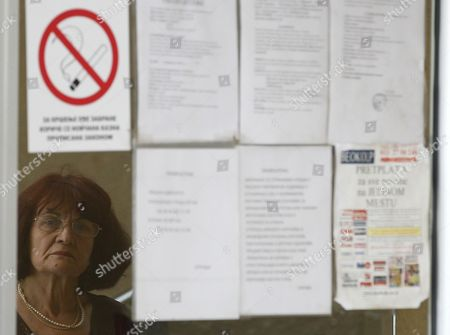 A reflection of Bosiljka Mladic, the wife of genocide suspect Ratko Mladic in front of the Special Court building in Belgrade, Serbia, . Ratko Mladic was arrested on Thursday in a village in Serbia after 16 years on the run