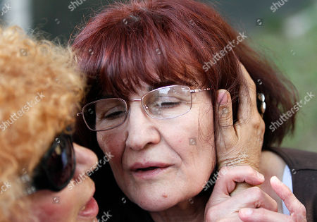 Bosiljka Mladic, Biserka Petrovska Domagadzijev Biserka Petrovska Domagadzijev, left, a family friend kisses Bosiljka Mladic, the wife of genocide suspect Ratko Mladic, in front of the Special Court building in Belgrade, Serbia, . Ratko Mladic was arrested on Thursday in a village in Serbia after 16 years on the run. Ratko Mladic is eating strawberries and receiving family visits in a Serbian jail, but as early as Monday the ex-general could be on his way to face a war-crimes tribunal in The Hague, possibly joining his former ally Radovan Karadzic on trial for some of the worst horrors of the Balkan wars