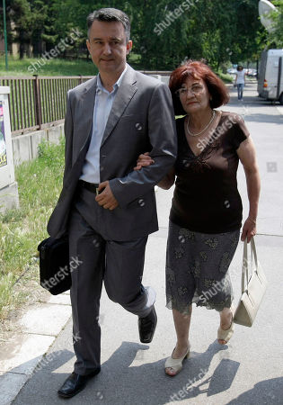 Bosiljka Mladic, the wife of genocide suspect Ratko Mladic, right, and their son Darko leave the Special Court building in Belgrade, Serbia, . Ratko Mladic was arrested on Thursday in a village in Serbia after 16 years on the run. Ratko Mladic is eating strawberries and receiving family visits in a Serbian jail, but as early as Monday the ex-general could be on his way to face a war-crimes tribunal in The Hague, possibly joining his former ally Radovan Karadzic on trial for some of the worst horrors of the Balkan wars
