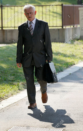 Milos Saljic Milos Saljic, the lawyer of Ratko Mladic, arrives at the Special Court in Belgrade, Serbia, early morning . As he awaited extradition to a U.N. tribunal, jailed war crimes suspect Ratko Mladic was allowed on Tuesday to visit the grave of his daughter who committed suicide during Bosnia's war. Mladic left his jail cell to make the early morning visit under tight security, including several armored vehicles, said Serbia's deputy war crimes prosecutor, Bruno Vekaric