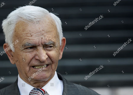 Stock Photo of Milos Saljic Milos Saljic, the lawyer of Ratko Mladic, talks to the media in front of the Special Court in Belgrade, Serbia, early morning . As he awaited extradition to a U.N. tribunal, jailed war crimes suspect Ratko Mladic was allowed on Tuesday to visit the grave of his daughter who committed suicide during Bosnia's war. Mladic left his jail cell to make the early morning visit under tight security, including several armored vehicles, said Serbia's deputy war crimes prosecutor, Bruno Vekaric