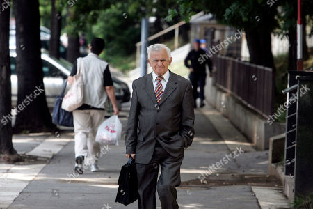 Milos Saljic Milos Saljic, center, the lawyer of Ratko Mladic's family, walks down a street in Belgrade, Serbia, . Saljic said Sunday that Ratko Mladic's mental state is alarming and that he should not be extradited to a UN war crimes tribunal
