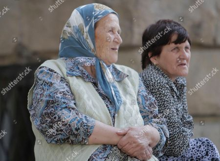 Bosiljka Mladic, Milos Saljic Two women sit in front of the Special Court building where Bosnian Serb wartime general Ratko Mladic is being held in Belgrade, Serbia, . Ratko Mladic was arrested on Thursday in a village in Serbia after 16 years on the run