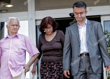 Bosiljka Mladic, Milos Saljic Bosiljka Mladic, the wife of genocide suspect Ratko Mladic, center, their son Darko, right, and the family's lawyer Milos Saljic, leave the Special Court building in Belgrade, Serbia, on . Genocide suspect Ratko Mladic in due in a Belgrade court for a hearing which is a legal step toward his extradition to a U.N. war crimes tribunal. Europe's most wanted war crimes fugitive was arrested Thursday in a northern Serbian village after 16 years on the run