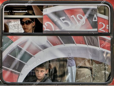 Stock Image of A boy looks from a bus at media gathered outside the the Special Court building where Ratko Mladic is being held in Belgrade, Serbia, . Milos Saljic, the lawyer for war crimes suspect Ratko Mladic says he has formally filed an appeal against the former general's detention, a move that will likely delay his extradition for at least a day