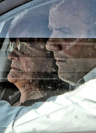 Bosiljka Mladic, the wife of Ratko Mladic, left, and Darko Mladic, his son, right, are are seen in a vehicle as the motorcade thought to be taking war crimes suspect Ratko Mladic to the plane that will take him to the Hague arrives to pick him up at the Special Court compound where he was held in Belgrade, Serbia