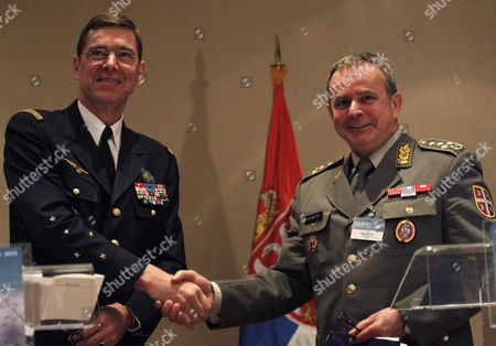 Stock Image of Stephane Abrial, Miloje Miletic General Stephane Abrial, NATO's Supreme Allied Commander Transformation (SACT) of France, left, shakes hands with Serbia's army chief Lt. Col. Gen. Miloje Miletic, in Belgrade, Serbia, . NATO held its annual conference in Belgrade in a sign of improving ties with the country the alliance bombed in 1999 over Kosovo