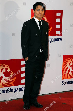 """Archie Kao American actor Archie Kao poses for photographers during the red carpet movie premier of the movie """"Larry Crowne"""" in Singapore"""