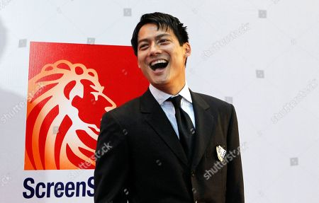 Archie Kao American actor Archie Kao smiles during the red carpet movie premier of the movie Larry Crowne in Singapore