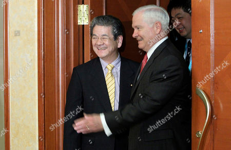 Robert Gates, Toshimi Kitazawa U.S. Secretary of Defense Robert Gates, right, enters a meeting room with Japan's Defense Minister Toshimi Kitazawa, left, for a bilateral meeting on the sidelines of the IISS Shangri-la Security Summit on in Singapore