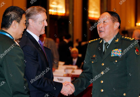 Liang Guanglie, William Cohen William Cohen of the United States, left, shakes hands with Liang Guanglie, China's minister for defense at the International Institute for Strategic Studies (IISS) Shangri-la Security Summit on in Singapore