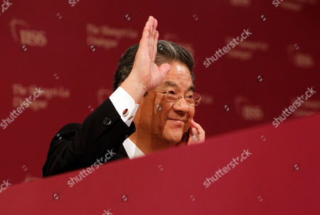 Toshimi Kitazawa Japan's Defense Minister Toshimi Kitazawa waves to delegates during the International Institute for Strategic Studies (IISS) Shangri-la Security Summit on in Singapore
