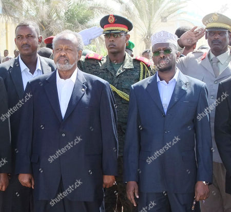 Djibouti president Ismail Omar Guelleh, left, and Somalia's President Sheik Sharif Ahmed, right, during their visit to a refugee camp in Mogadishu Somalia
