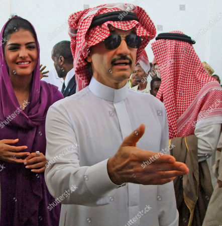 Prince Al-Waleed bin Talal Bin Abdulaziz Alsaud, Chairman of the Alwaleed Bin Talal Foundation, right, nephew of King Abdullah of Saudi Arabia, and his wife Princess Amira, left, on their arrival in Mogadishu, Somalia to witness the famine in the Somali capital