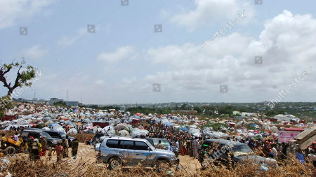General view of the refugee camp where Saudi Prince Al Waleed bin Talal Bin Abdulaziz Alsaud, Chairman of the Al Waleed bin Talal Foundation, centre, during a visit to a refugee camp in Mogadishu, Somalia, to witness the famine in the Somali capital