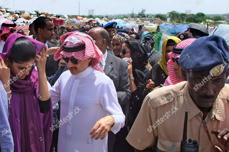 Prince Al-Waleed bin Talal Bin Abdulaziz Alsaud, Chairman of the Alwaleed Bin Talal Foundation, center, nephew of King Abdullah of Saudi Arabia, and his wife Princess Amira, left, on their arrival in Mogadishu, Somalia to witness the famine in the Somali capital