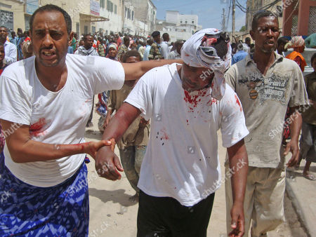 A man help a wounded civilian who was injured during a protest in Mogadishu, Somalia, where protesters took to the streets for the second day in support of current Prime Minister Mohamed Abdullahi Farmajo. A new accord extending the government's term by a year requires Prime Minister Mohamed Abdullahi Mohamed to resign in a month, but Mohamed is popular with many Somalis because he has managed to pay salaries for government workers and soldiers and attack corruption since he came to power in October last year