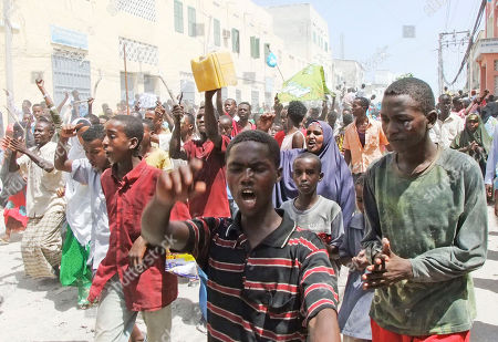 Somali protesters march in Mogadishu, Somalia, where protesters took to the streets for the second day in support of current Prime Minister Mohamed Abdullahi Farmajo. A new accord extending the government's term by a year requires Prime Minister Mohamed Abdullahi Mohamed to resign in a month, but Mohamed is popular with many Somalis because he has managed to pay salaries for government workers and soldiers and attack corruption since he came to power in October last year