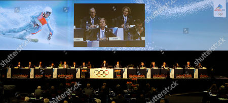 Stock Picture of Charles Beigbeder Charles Beigbeder, President of Annecy 2018, seen on the large screen, takes questions after their presentation at the 123rd IOC session in support of Annecy's bid to host the 2018 Winter Games in Durban, South Africa, . The International Olympic Committee will announce the host city for the 2018 Winter Olympics in Durban. The IOC members will choose between three candidates Annecy, France; Munich Germany; and Pyeongchang, South Korea for the 2018 host