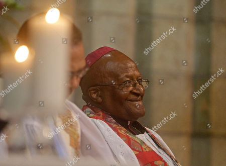 South African Archbishop Desmond Tutu reacts during a memorial for Albertina Sisulu, wife of South African anti apartheid leader Walter Sisulu in Cape Town, South Africa, . Albertina Sisulu, a leading figure during the struggle against apartheid by South African women, died at the age of 92